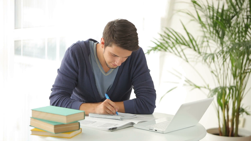 charming-young-man-studying-at-table-with-laptop-and-books_ekhmqxwrl__F0000 Six Sigma Certification Eligibility - Are You Eligible For The Green Belt?